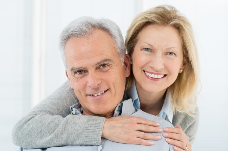 happy: Portrait Of Happy Senior Couple Smiling at Home