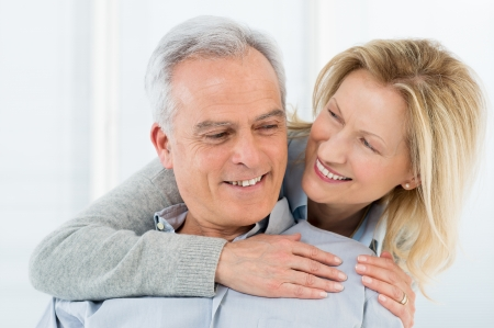affectionate: Portrait Of Happy Senior Couple Smiling Stock Photo