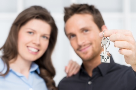 Happy Couple Owner Of New House With Keys photo