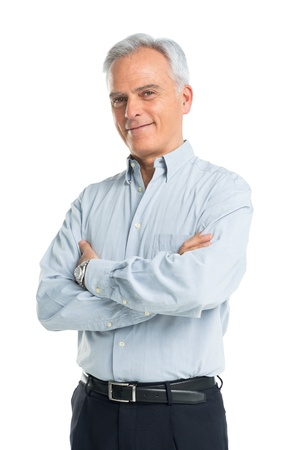 Happy Mature Man With Arms Crossed Stock Photo