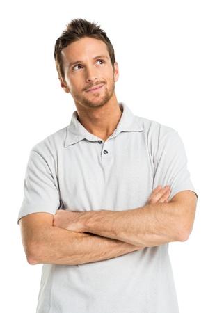 hombre: Retrato de hombre joven pensativo aislado sobre fondo blanco Foto de archivo