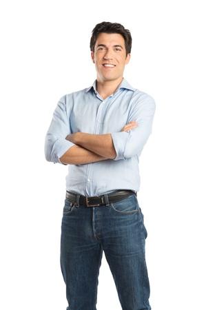 Gelukkig Jonge Man Met Arm gekruist geïsoleerd op een witte achtergrond Stockfoto