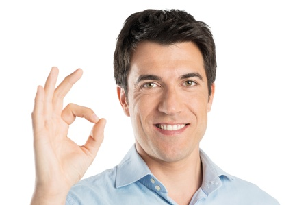 Satisfied Positive Man Gesturing Ok Sign Isolated On White Background Stock Photo - 20837546