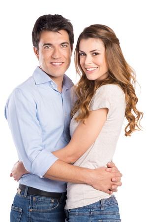 hispanic couple: Portrait Of Young Couple Hugging Isolated On White Background Stock Photo