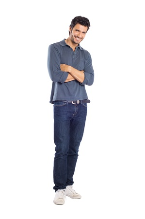 man in jeans: Happy Young Man With Arm Crossed Isolated On White Background Stock Photo