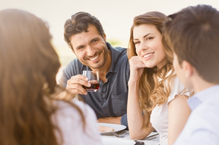 Group Of Happy Young Friends Enjoying Dinner Outdoor Stock Photo - 20837992