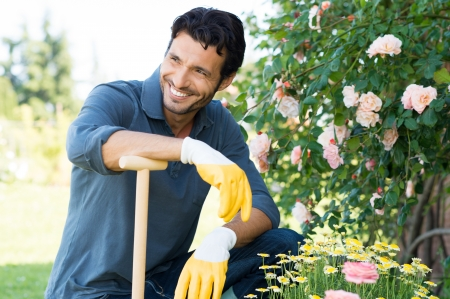 gardening gloves: Happy Man Gardening Outdoor in Spring