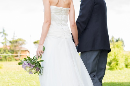 outdoor wedding: Closeup Of Newly Married Couple Walking Together Outdoor