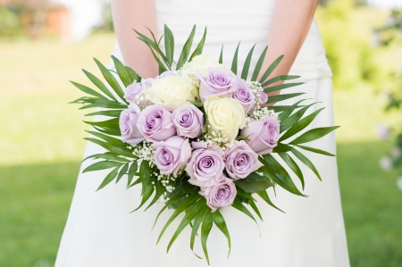 Closeup Of Bride Holding Beautiful Rose Bouquet  photo