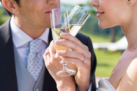 Closeup Of Bride And Groom Drinking Champagne Outdoor photo