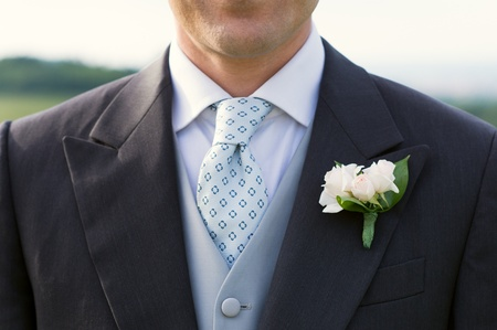 Closeup Of A Handsome Groom In Full Suit  photo