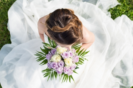 bridal: High View Of A Beautiful Young Bride Holding Bouquet
