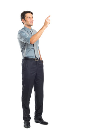 daydream: Young Businessman Pointing Isolated Over White Background Stock Photo