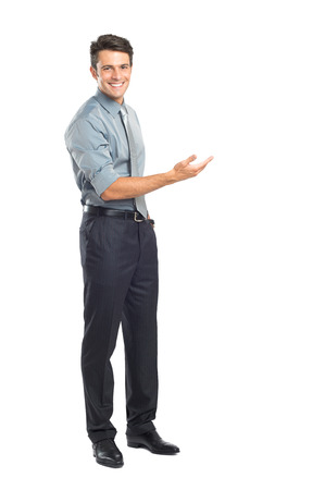 presenting: Happy Young Businessman Presenting Isolated Over White Background