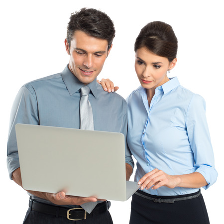 laptop stand: Young Businessman And Businesswoman Looking At Laptop Isolated On White Background
