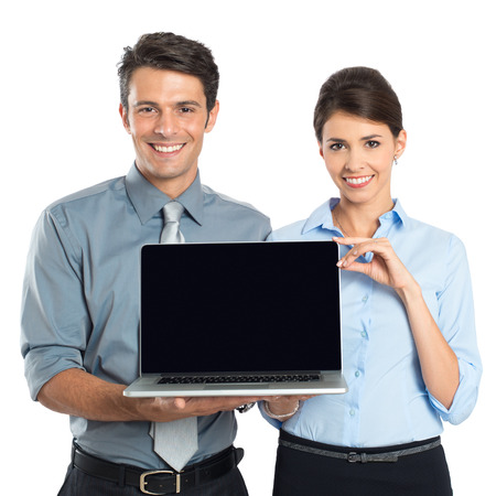salesmen: Happy Young Businessman And Businesswoman Showing Laptop Isolated On White Background