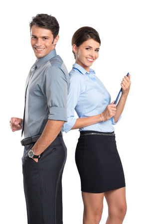 business woman standing: Portrait Of Happy Business Couple Standing Together Isolated On White Background Stock Photo
