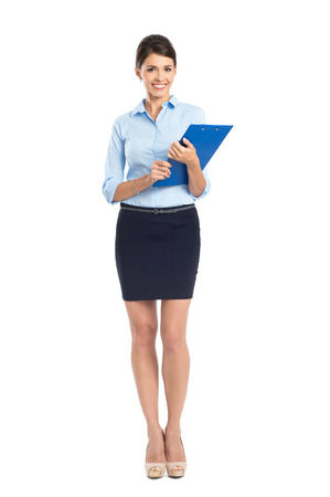 Portrait Of Happy Young Businesswoman Standing Isolated Over White Background Stock Photo - 22583699