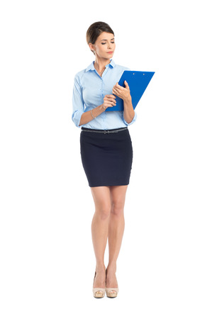 businesswoman: Portrait Of Young Businesswoman With Clipboard Isolated On White Background