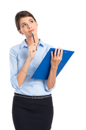 Thoughtful Young Businesswoman Holding Clipboard On White Background Stock Photo - 22583710