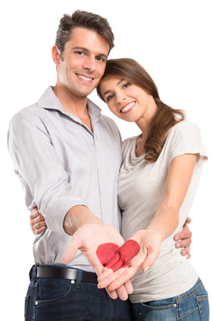 Young Smiling Couple With Heart Painted On Hand Isolated OnWhite Background photo