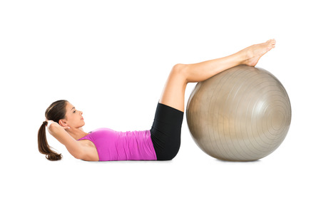 sit ups: Young Woman Doing Sit Ups With Pilate Ball Isolated On White Background