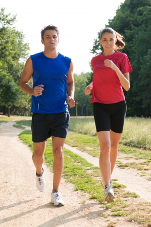 joggers: Portrait Of A Healthy Young Couple Jogging Outdoors