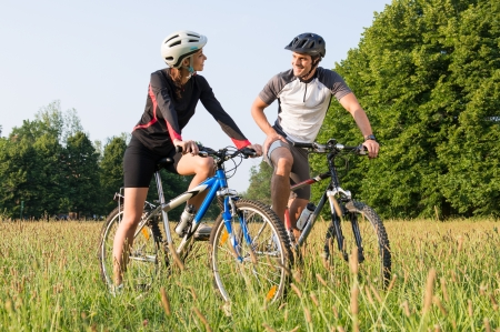 Two Young Cyclist On Bicycle Looking At Each Other Stock Photo - 22583743