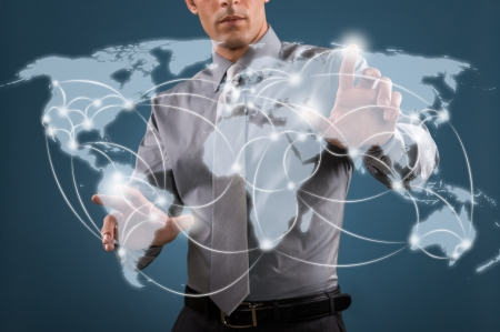 international network: Businessman working on a digital map of the world, worldwide communication and network concept