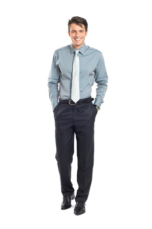 smiling young man: Confident Businessman With Hand In Pocket Isolated On White Background