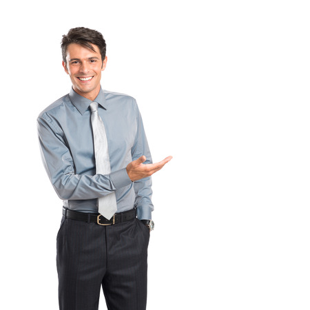 indicate: Happy Young Businessman Showing Iaolated On White Background Stock Photo