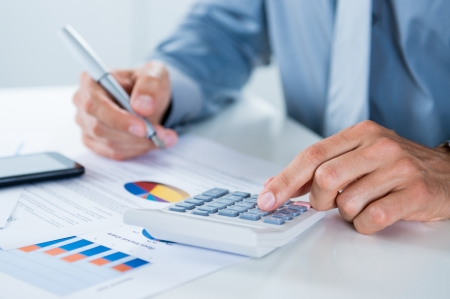 account executives: Close Up Of A Businessman With Documents At Desk Doing Calculations