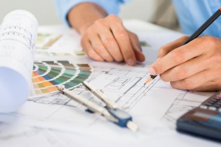 draftsman: Close Up Of A Male Draftsman Drawing Plan On Blueprint