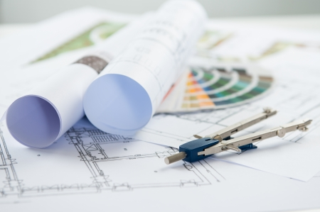 drafting tools: Close Up Of Architectural Blueprints And Compass On Desk Stock Photo