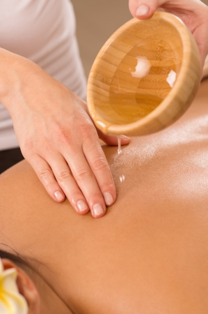 Close Up Of Woman Enjoying A Ayurveda Oil Massage   photo