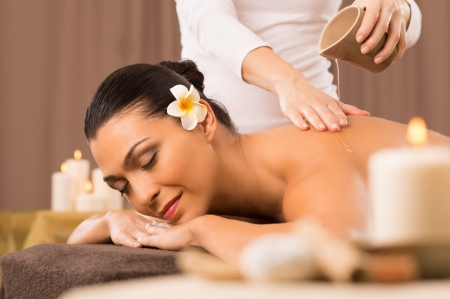 Relaxed Woman Receiving A Back Massage At Health Spa photo