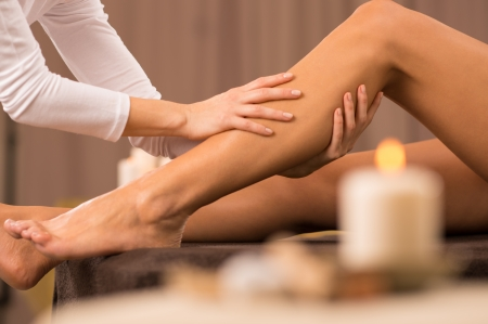 young woman legs up: Woman Getting Massage Treatment