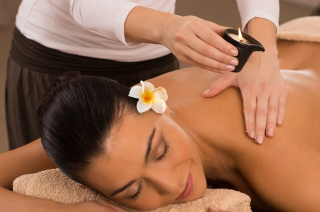 massage therapy: Relaxed Woman Receiving A Candle Massage