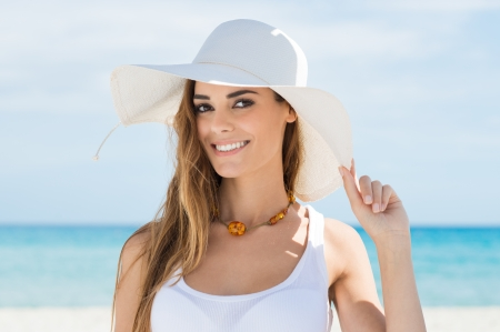 Happy Beautiful Girl With White Hat On Beach