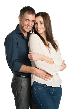 latin people: Portrait Of A Embracing Couple Looking At Camera Isolated On White