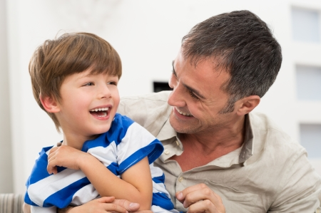 Happy Father And Son Playing With Each Other Stock Photo