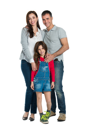 standing: Portrait Of A Happy Family Looking At Camera Isolated On White