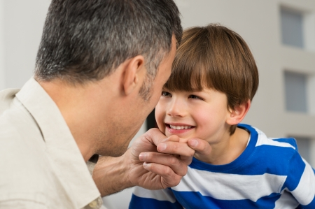 Close-up Of Father Looking At His Smiling Son Stock Photo - 25271843