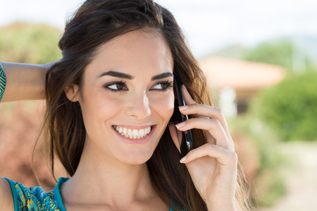 Close Up Of A Attractive Young Woman Speaking On Mobile Phone photo