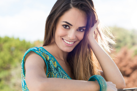 Portrait Of A Happy Young Woman Looking At Camera  Stock Photo