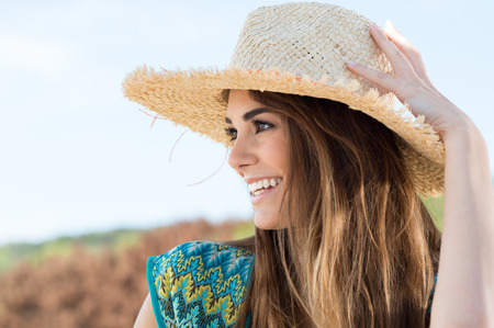 Close Up Of A Happy Smiling Girl With Sunhat photo