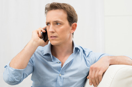 Portrait Of Worried Young Man On The Phone
