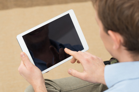 blank tablet: Closeup Of Person Holding Digital Tablet With Blank Screen Stock Photo
