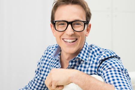 eyeglass: Portrait Of Happy Young Man Wearing Eyeglasses Stock Photo