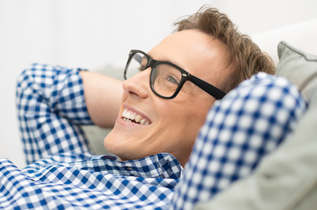 Portrait Of Happy Man Contemplating With Eyeglasses photo